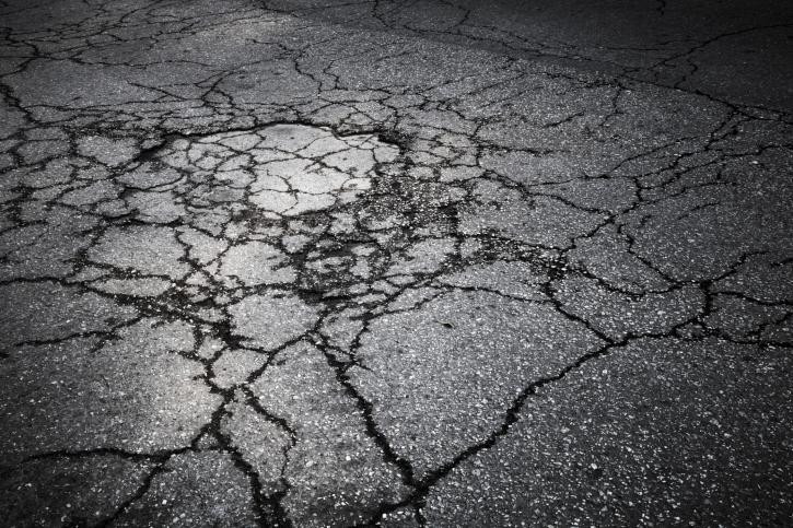 cracked parking lot asphalt